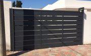 התקנת שערים חשמליים לחניה של בית פרטי – דגם שניר 16